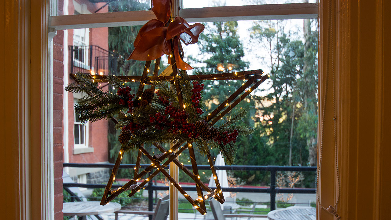A Christmas Star Hangs In The Window At Inn at the Presidio