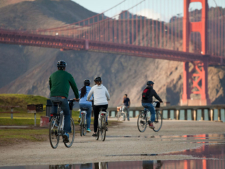 A Family Bike Riding At Crissy Field